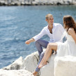 Bride and groom relaxing near sea after wedding, Naples, Italy — Stock Photo #61842267