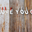 I love you words and heart shaped decor on wooden background - valentines day — Stock Photo #63469077
