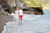 Happy couple walking on the beach of Positano in wedding day — Stock Photo