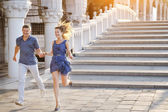 Happy couple smiling and running in Venice, Italy — Stock Photo