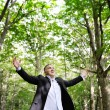 Happy man enjoying nature - freedom happiness concept — Stock Photo #67574405