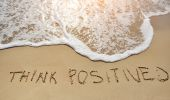 Think positive written on sand beach - positive thinking concept — Stock Photo
