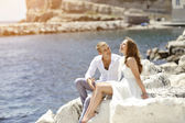 Young couple bride and groom smiling and relaxing near sea, Naples, Italy — Stock Photo
