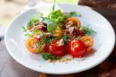 Simple appetizer with cherry tomatoes and smoked duck fillet — Stock Photo