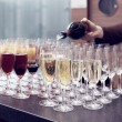Bartender is pouring sparkling wine in glasses, toned image — Stock Photo #59338433