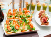 Shrimp appetizers on banquet table — Stock Photo