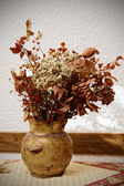 Dried boquet in pot, toned image — Stock Photo