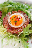 Beef tartare in plate, close-up — Stock Photo