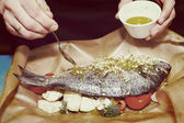 Chef is cooking dorade, toned — Stock Photo
