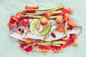 Dorade with vegetables prepared for roasting, toned — Stock Photo