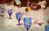 Pouring wine - winetasting event, toned image — Stock Photo