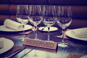 Reserved plate on an arranged table, toned image — Stock Photo