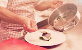 Chef is serving steamed seabass, toned — Stock Photo