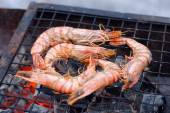 Shrimps on charcoal grill — Stock Photo
