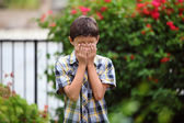 Young boy playing outside — Stock Photo