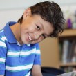 Smiling young boy — Stock Photo #63942309