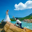 Loving couple on sea beach - a man making proposal with bouquet  — Stock Photo #54893403