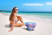 Beautiful woman in bikini sunbathing at the seaside — Stock Photo