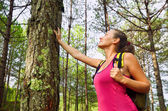 Woman enjoying the beautiful pines travel green forest in Europe — Stock Photo