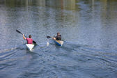 Two men in a canoes — Stock Photo