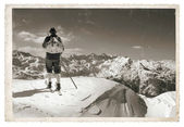 Old photo with old skier — Stock Photo