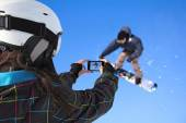 Photographed snowboarder jump with cell phone — Stock fotografie