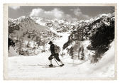 Skier with vintage skis — Stock Photo