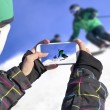 Photographed two skiers with cell phone — Stock Photo #61925605