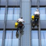 Two climbers wash windows — Stock Photo #66150613
