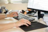 Business woman typing — Stock Photo