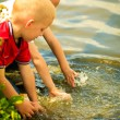 Little boys playing playing with water outdoor washing hands — Stock Photo #51828469
