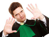 Law. Man lawyer in polish gown showing stop hand sign — Stock Photo