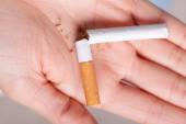 Addiction. Broken cigarette on hand. Quit smoking — Stock Photo