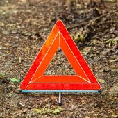 Breakdown of car. Red warning triangle sign on road — Stock Photo