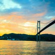 Sunset over suspension bridge in Bergen, Norway — Stock Photo #51876365