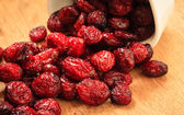 Dried cranberry fruit in bowl on table. — Stock Photo