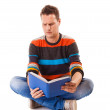 Male student reading a book preparing for exam isolated — Stock Photo #52078643
