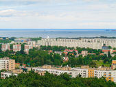 Aerial view from tower of district gdansk buildings and sea. — Stock Photo