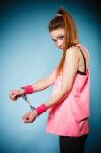 Teen crime - teenager girl in handcuffs — Stock Photo