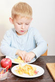 Happy childhood. Boy child kid eating peeled apple fruit. At home. — Stock Photo