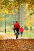 Cycling outdoors man on bike, golden autumn in park — Stock Photo