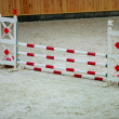 Red white obstacle for jumping horses. Riding competition. — Stock Photo #52259591