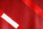Piece scrap paper blank copy space on red leather background — Stock Photo