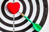 Black white target with dart in heart love symbol as bullseye — Stock Photo