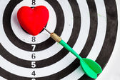 Black white target with dart in heart love symbol as bullseye — Foto Stock