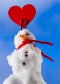Little happy valentine snowman red heart love symbol outdoor. Winter. — Stock Photo