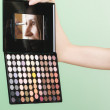 Colorful eyeshadows palette with makeup brush — Stock Photo #52413025
