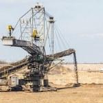 Opencast brown coal mine. Giant excavator. — Stock Photo