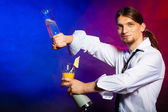 Young man bartender pouring a drink — Stock Photo