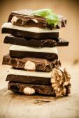 Stack of different sorts chocolate and walnut — Stock Photo